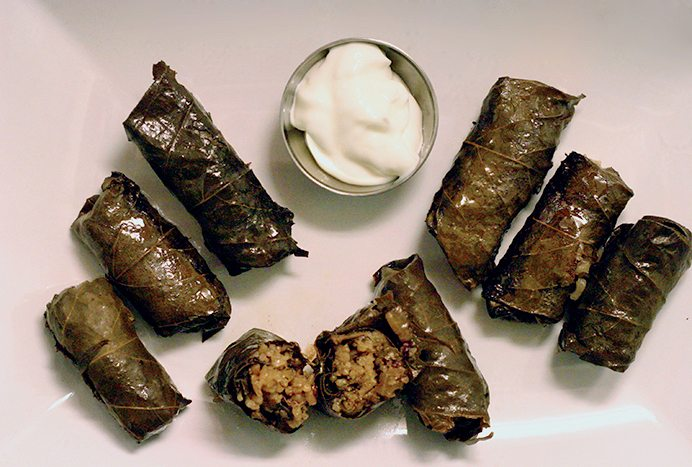 Stuffed vine leaves with liver and apple with yogurt