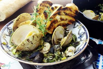 Sauteed Clams Oysters and Snails with Sea Greens